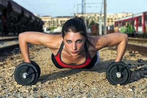 Pumps dumbbells: Fitness girl