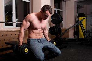 Concentrated body builder ready to lift photo