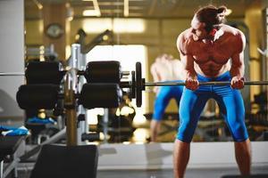 Bodybuilder in gym photo