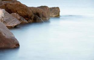 Stones in the surf photo