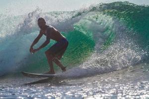 Surfing a Wave. Bali Island. Indonesia.