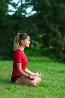 Cute young girl doing yoga exercises photo