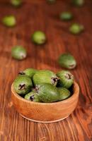 Fruits of feijoa in a wooden bowl photo