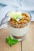Yogurt with granola and fruits photo