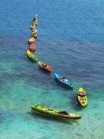 Line of colorful kayaks
