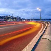Car light trails and urban landscape.
