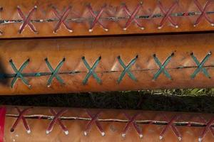 Stitching on oars, close-up