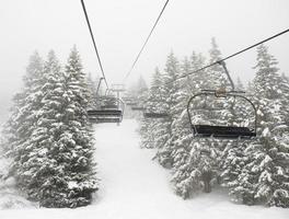 ski lift in mist