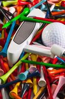 Various wooden golf tees and other equipments