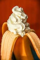 Banana with whipped cream photo