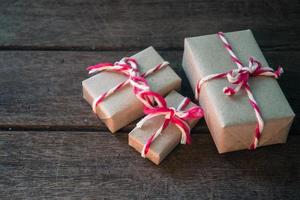 Gift box on wooden background photo