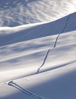 Off-piste ski track photo