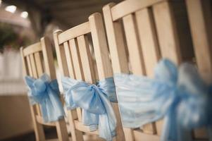 Wedding chairs decorated in blue color photo