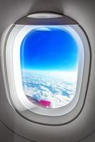 Airplane Porthole Window and Summer Clouds photo