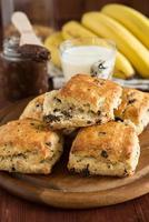 Scones with chocolate, served with banana and cocoa spread
