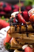 sweet waffles with fruits and chocolate