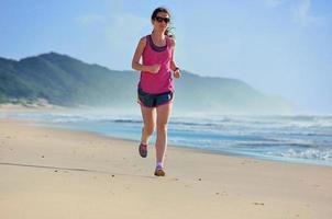 Woman running on beach photo
