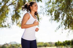 Cute young woman running