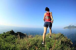young fitness woman trail runner enjoy the view photo