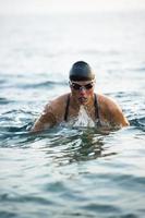 Female swimmer at breaststroke in the sea