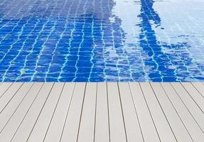 Swimming pool and wooden deck ideal for backgrounds