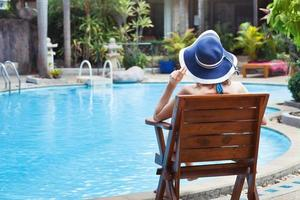 woman relaxing near swimming pool
