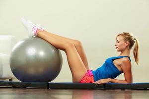 woman doing fitness exercises with fit ball photo