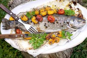 Trout with tomatoes photo