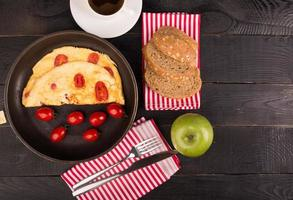 Omelette with tomatoes photo