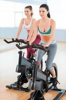 Women on exercise bikes. photo