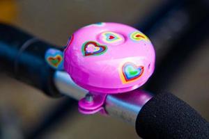 campana de bicicleta rosa