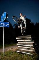 Urban freestyle trial bicycle rider photo
