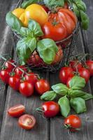 Colorful  tomatoes in  basket photo