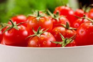 Tomatoes inside white bowl photo