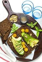 breakfast with sandwich with avocado on a cutting