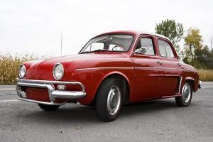 A vintage old red car in decent shape