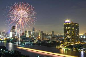 fireworks with bangkok cityscape river view at twilight scene, t photo