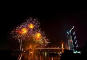 Multicolor fireworks night scene, bangkok cityscape river view, photo