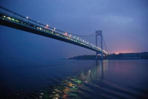 New York Ciy's Verranzano-Narrows Bridge at sunrise reflecting in water photo