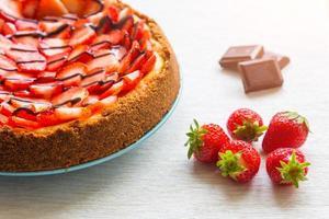 New York cheesecake met chocolade en aardbeien