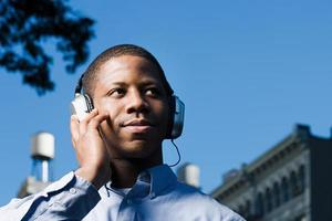 Man listening to headphones photo