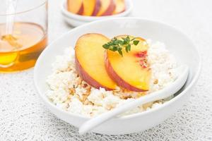 cottage cheese with honey, nuts, fresh peaches and thyme
