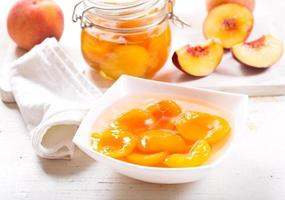 canned peaches in a bowl photo