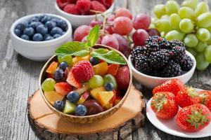 fruit salad in a bamboo bowl and fresh berries