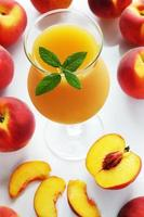 Fresh juice from peaches with mint
