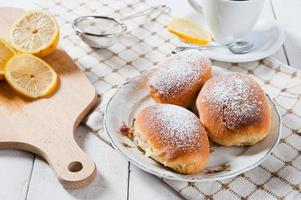 Freshly baked sweet buns with jam