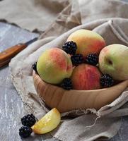 Fresh ripe peach and blackberry photo