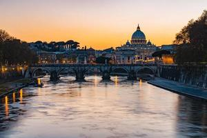 Twilight view of Rome at St. Peters cathedral in Italy photo