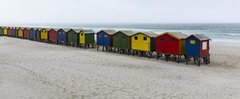 Panoramic view, brightly colored cabanas in fog, Muizenberg, South Africa