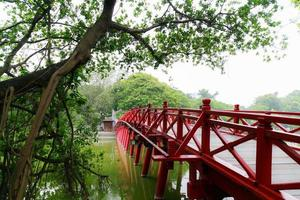 wooden railings of Huc Bridge in Hoan Kiem Lake